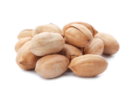 Heap of pecan nuts in shell on white background