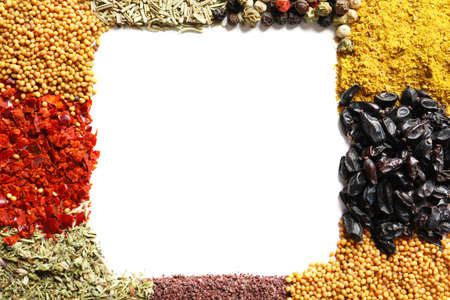 Frame made of different aromatic spices on white background, top view with space for text Stock Photo
