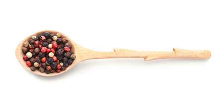 Wooden spoon with different pepper grains on white background, top view