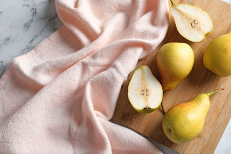 Flat lay composition with ripe pears on marble background Stock Photo