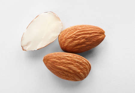 Organic almond nuts on white background, top view. Healthy snack Stock Photo