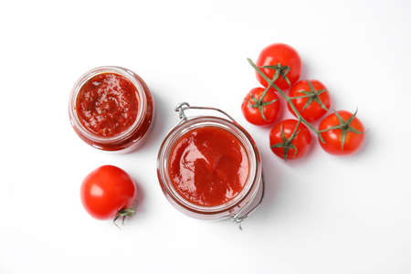 Composition with tasty homemade tomato sauce on white background, top view Stock Photo