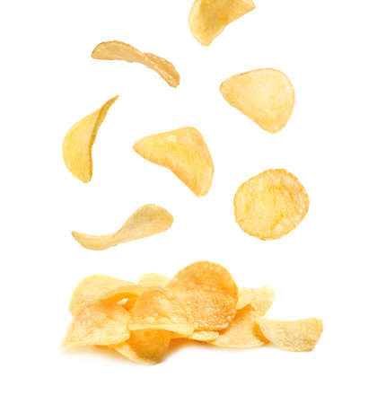 Tasty potato chips falling on white background 스톡 콘텐츠