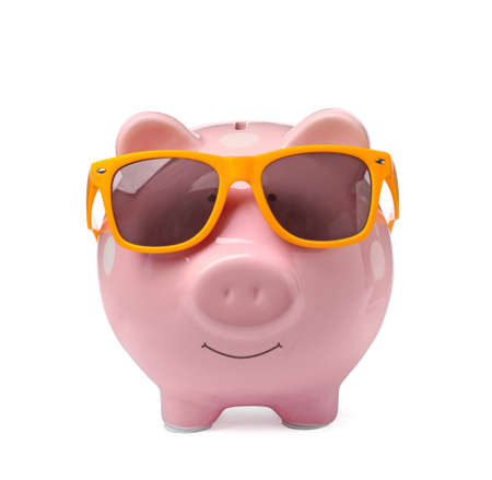 Piggy bank with sunglasses isolated on white