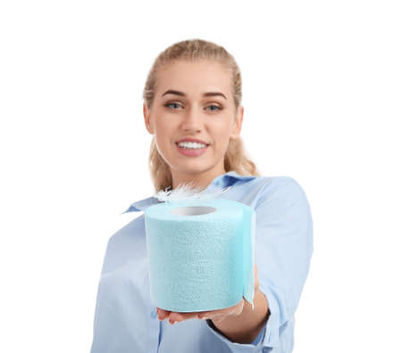 Beautiful young woman holding toilet paper roll on white background Stock Photo