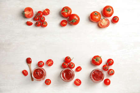 Composition with tasty homemade tomato sauce and space for text on white background, top view