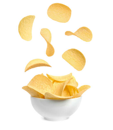 Tasty potato chips falling into blow on white background