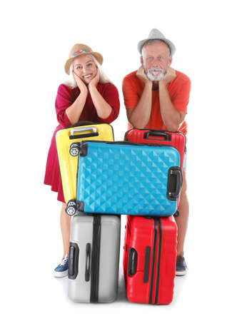 Senior couple with suitcases on white background. Vacation travel 版權商用圖片