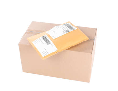 Padded envelope and cardboard parcel on white background