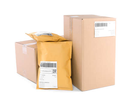 Padded envelopes and cardboard parcels on white background