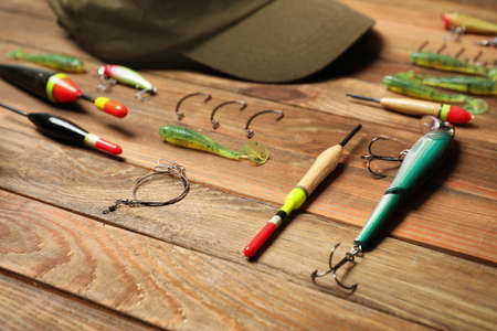 Fishing tackle on wooden table. Recreational activity Stock Photo