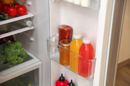 Open refrigerator with fresh food on shelves