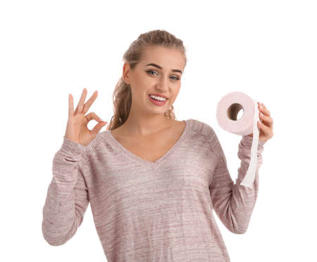 Beautiful young woman holding toilet paper roll on white background Фото со стока