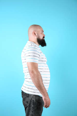Fat man on color background. Weight loss