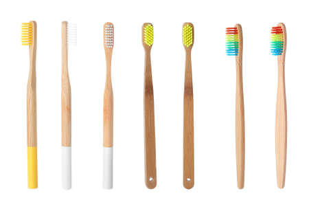 Set with bamboo toothbrushes on white background Imagens