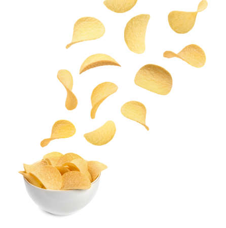 Tasty potato chips falling into blow on white background Foto de archivo - 111432861