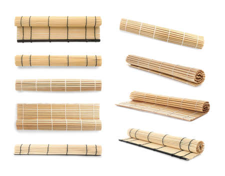 Set with bamboo mats on white background