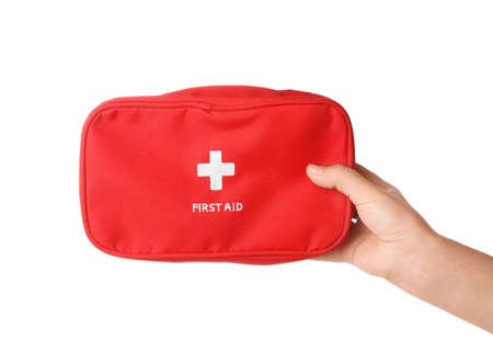 Woman holding first aid kit on white background