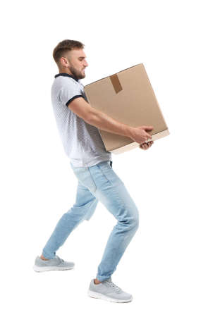 Full length portrait of young man carrying carton box on white background. Posture concept 스톡 콘텐츠