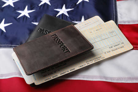 Passports and tickets on flag of USA