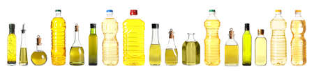 Set with different bottles of oil on white background