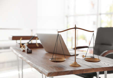 Scales of justice on desk in notary's office
