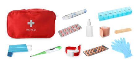Medical items and red case on white background. Packing first aid kit