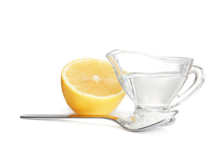 Composition with vinegar, lemon and baking soda on white background Banco de Imagens
