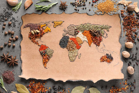 Paper with world map made of different aromatic spices on gray background, flat lay Standard-Bild - 111539639
