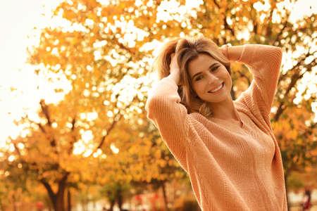 Portrait of beautiful woman in park. Autumn walk