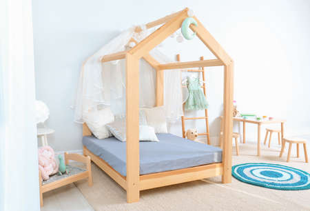 View of cozy child's room interior with cute bed Archivio Fotografico