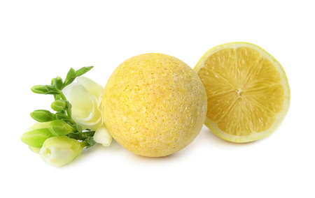 Bath bomb, flowers and lemon on white background