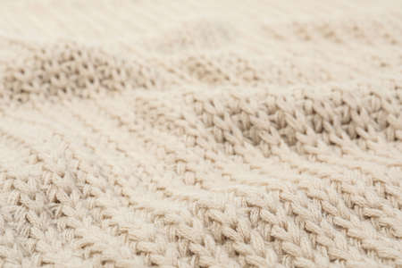 Texture of cozy warm sweater as background, closeup Banco de Imagens