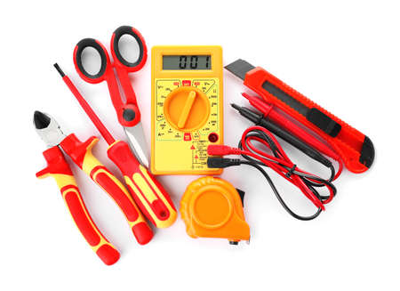 Set of electrician's tools on white background, top view