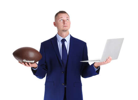 Portrait of businessman with ball and laptop on white background. Combining life and work