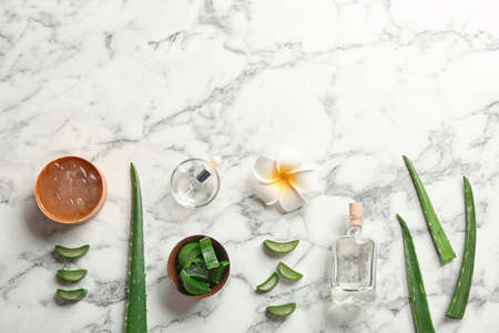Flat lay composition with aloe vera leaves on marble background. Space for text Фото со стока