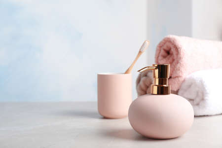 New stylish soap dispenser on table. Space for text Reklamní fotografie