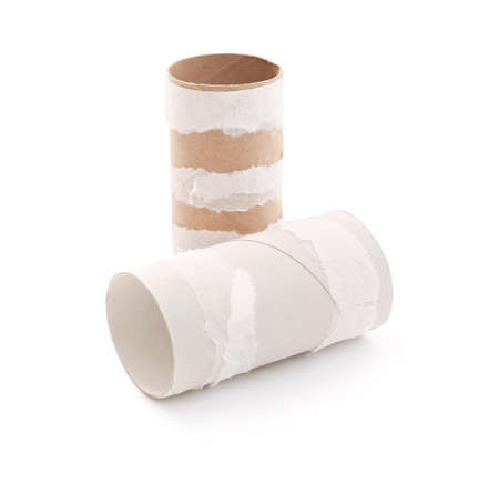 Empty paper toilet rolls on white background