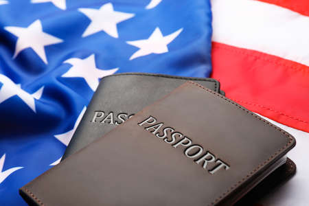 Passports in leather covers on flag of USA