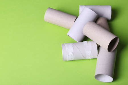 Empty toilet paper rolls and space for text on color background Stock Photo - 111782227