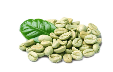 Green coffee beans and fresh leaf on white background