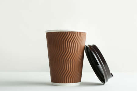 Takeaway paper coffee cup and lid on white background Archivio Fotografico