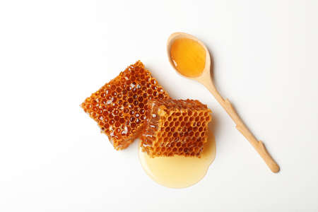 Composition with fresh honeycombs on white background, top view