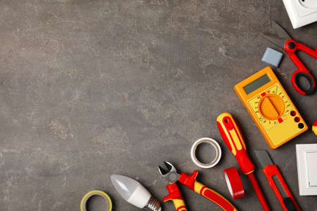 Flat lay composition with electricians tools and space for text on gray background