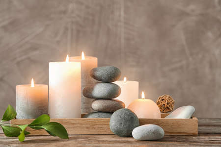 Composition with spa stones on wooden table Stock Photo - 111970527