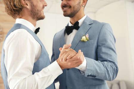 Newlywed couple dancing at home, closeup