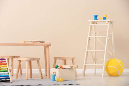 Stylish child's room interior with toys and new furniture Stock Photo