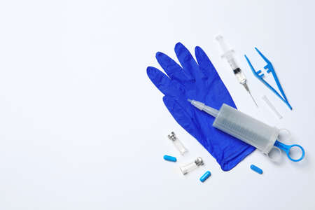 Flat lay composition with medical glove on white background. Space for text