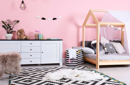 Modern child's room interior with cute bed