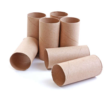Empty paper toilet rolls on white background